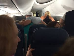 Tragic Story Of Plane Passengers Coming Together To Try To Save A Dying Man's Life