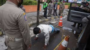 Indonesian Men Forced To Do Press Ups For Not Wearing A Mask