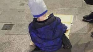 Tragic Photo Shows Homeless Boy Eating Dinner Off Piece Of Cardboard