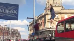 England Fan Crashes Through Bus Stop Roof After Leaping From Bus