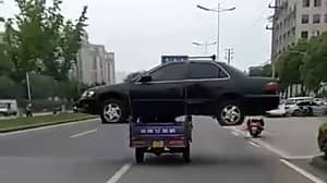 Bizarre Footage Shows Pedicab Carrying Saloon Car Along Busy Road