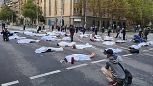 Extinction Rebellion Protestors 'Lie Dead' On Busy Melbourne Road For Climate Rally