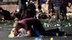 Photographer Says Couple Pictured On The Ground During Las Vegas Shooting Survived