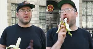Prankster Eats Banana Seductively Outside Chinese Embassy To Protest Ban