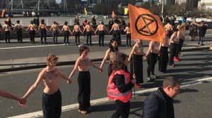 Topless Women Form Chain On Waterloo Bridge In Climate Change Protest