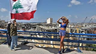 Couple Face Backlash For Photoshoot On Beirut Explosion Site