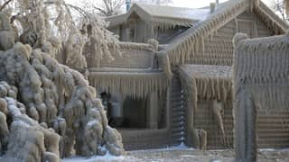 Houses Near Lake Erie In New York Resemble Igloos Amid Blizzards
