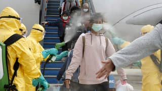 Passengers From Wuhan Sprayed Down By Officials After Landing In Indonesia