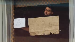 Man Who 'Lost Job' Holds Protest Sign To Boris Johnson From Inside Quarantine Hotel