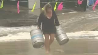 Queensland Woman Jumps Into Ocean To Rescue Beer Kegs During Dramatic Flooding