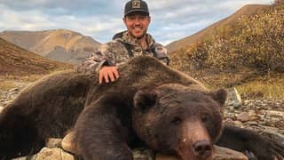 Hunter Receives Vicious Death Threats After Posing With Huge Bear He Killed