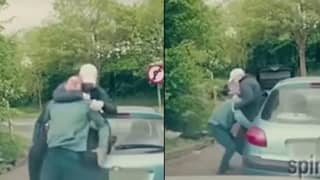 Baseball Bat Wielding Road Rager Gets Instant Karma From Driver