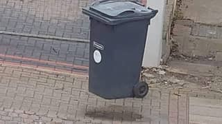 The Photo Of A Floating Wheelie Bin' Has People Scratching Their Heads
