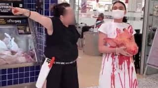 Butcher Faces Off Against Vegan Activist Holding Pig's Head In Shopping Centre