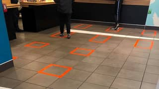 McDonald's Store Marks Out Where Customers Should Stand To Socially Distance Themselves From Others