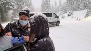 US Health Workers Offer Vaccine Doses To Motorists Stranded In Traffic