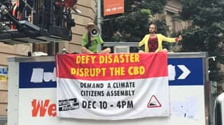 Police Shut Down Climate Activists Who Blocked Busy Brisbane CBD Road During Protest