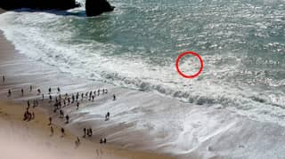 Beachgoers Link Arms And Form Incredible Human Chain To Save Man