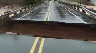 Bridge Splits During Live News Broadcast As Reporter Covers Impact Of Storm Eta