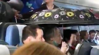 Passengers On Russian Flight Put Up Umbrellas After It Starts 'Raining'