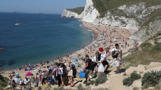​People Flock To UK Beaches Despite Continued Warnings On Social Distancing Measures