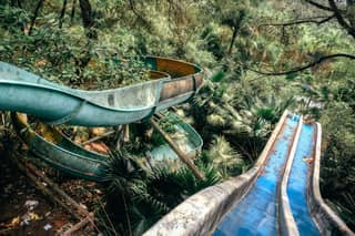 Take A Look Inside The Spooky Abandoned Water Park That's Overrun With Vines