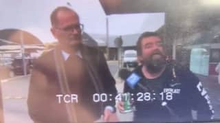 Man Carrying VB Interrupts TV Interview To Give His Two Cents On NSW-VIC Border Closure