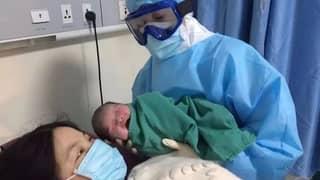 Wuhan Medics Deliver Coronavirus Patients' Baby Wearing Hazmat Suits