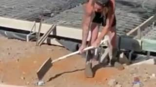 Aussie Tradie Hits A Spray Paint Can With A Shovel