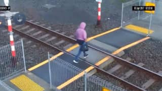 Woman Avoids Getting Hit By A Train Within Inches In Shocking Footage