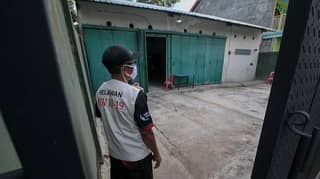 Coronavirus Quarantine Breakers Locked Away In 'Haunted Houses' In Indonesia