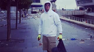 Liverpool Fan Volunteers To Help Clean Up Following The Celebrations