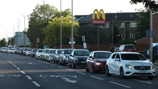 Cars Queue Down The Street As McDonald's Restaurants Reopen For Drive-Thru
