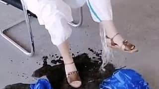 Coronavirus Medic In China Pours Out Buckets Of Sweat From Her Hazmat Suit