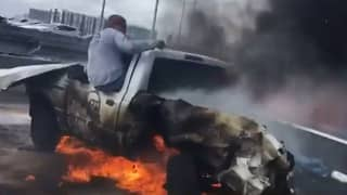 Shocking Video Shows Man Pulling Driver From Burning Car