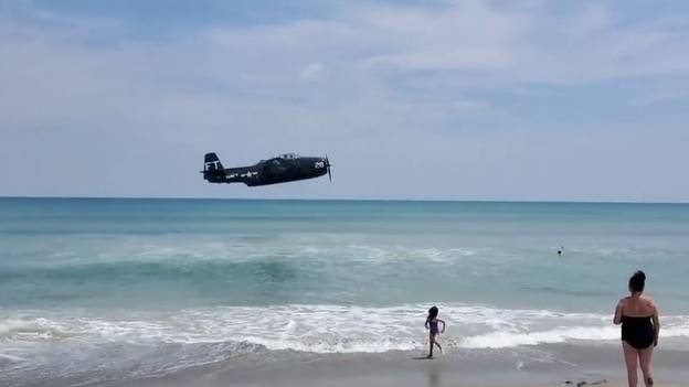 World War Two Plane Crashes Into Sea Close To Shore On Busy Beach