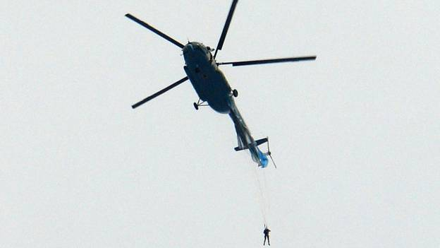Parachutist Left Dangling From Helicopter After Chute Snagged