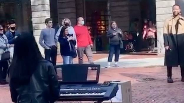 John Legend Watches On As Busker Performs One Of His Songs