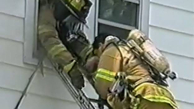 Firefighter Administers CPR On Baby While Climbing Down Ladder