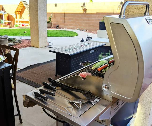 There is a large yard with barbecue.  Credit: Airbnb