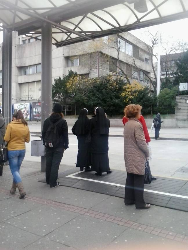 The woman standing at the bus stop. Credit: Kennedy News and Media