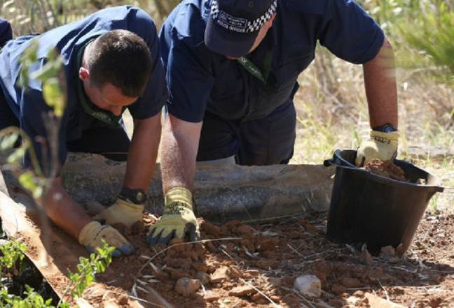 British police conduct a finger-tip search of an area of scrubland close to where Madeleine McCann went missing. Credit: PA