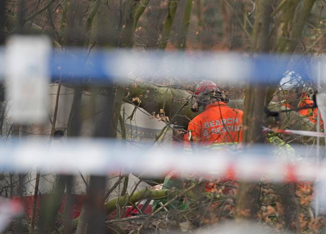 Emergency services near Black Wood in Woolton, Liverpool. Credit: PA