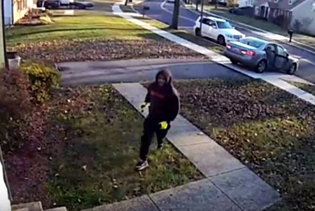 The moment this robber goes for the TV - the luminous yellow gloves are a fabulous addition. Credit: Prince George's County Police Department