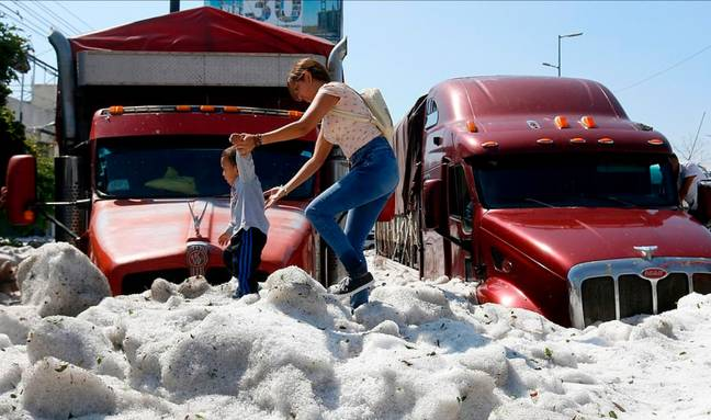Vehicles have been buried by the hail. Credit: Getty