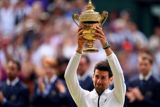 Novak Djokovic with his trophy. Credit: PA