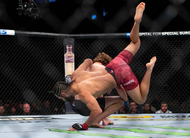 Jorge Masvidal, lands a flying knee on Ben Askren. Credit: PA