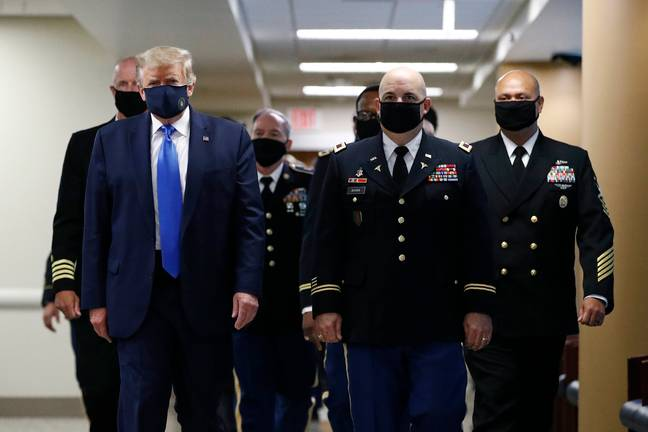 Donald Trump has finally worn a face mask in public. Credit: PA