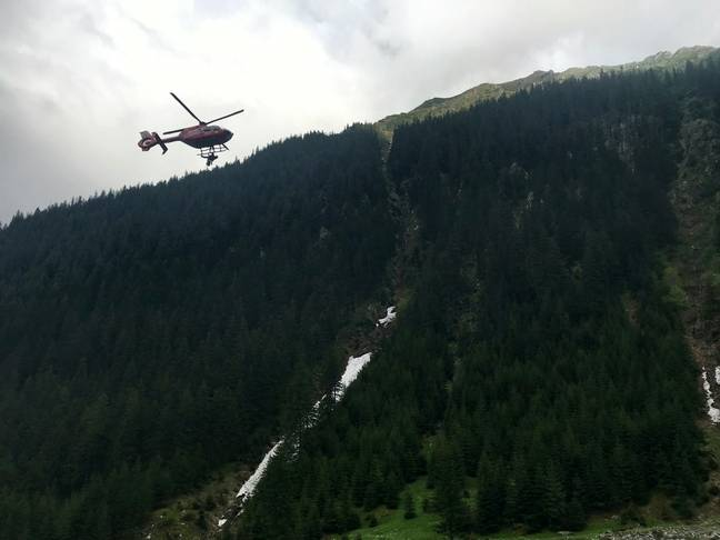 Lara was able to raise the alarm and a helicopter came to their rescue. Credit: SWNS