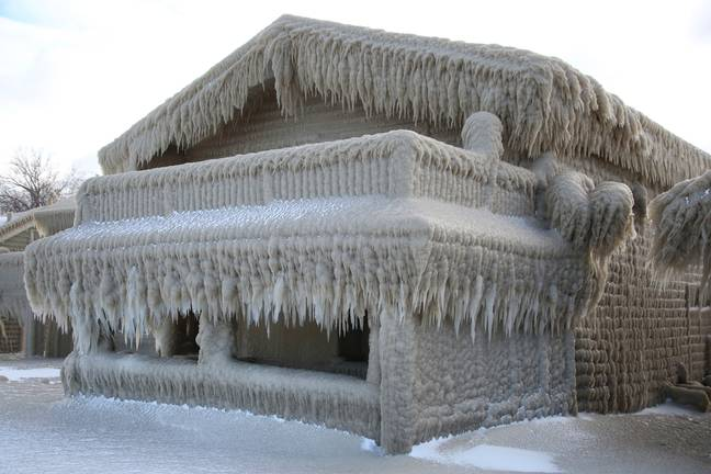 Houses are encased in ice near Lake Erie. Credit: PA